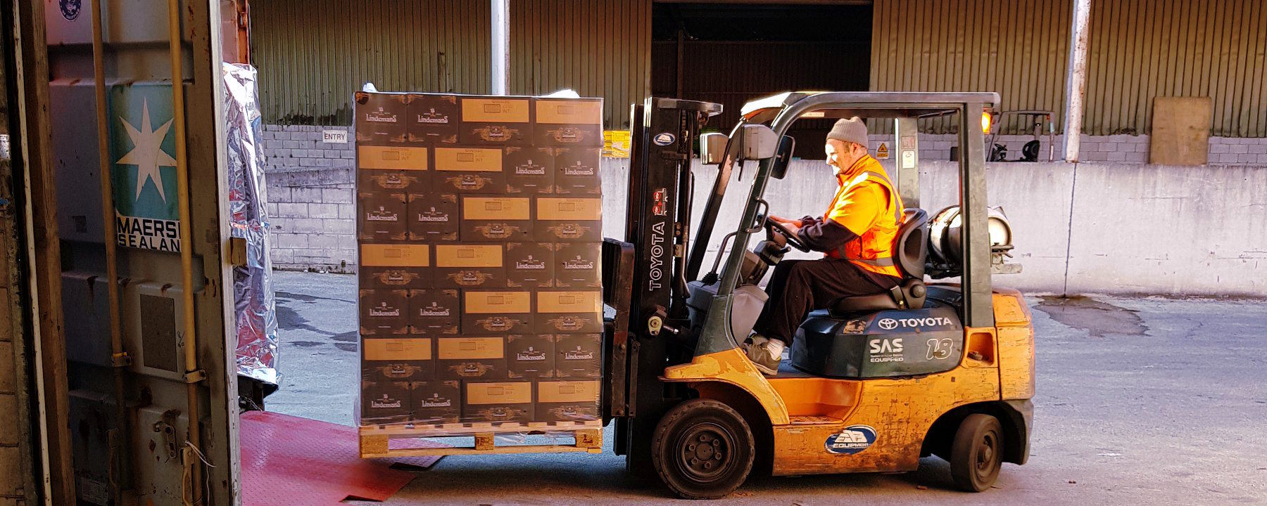 Shipping container and beers on forklift - Exceptional Flavours